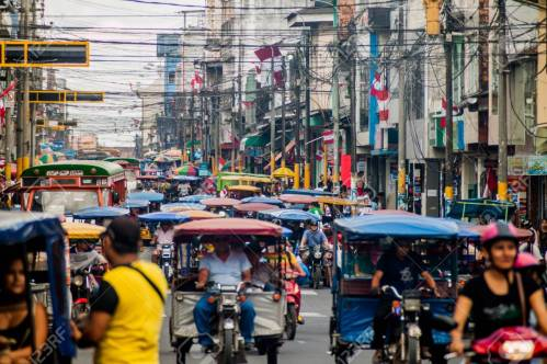63407803-iquitos-peru-june-18-2015-view-of-a-street-full-of-mototaxis-in-iquitos-peru.jpg
